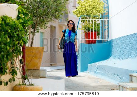 Photo Of The Beautiful Young Woman Walking On The Street Of Sunny Greece