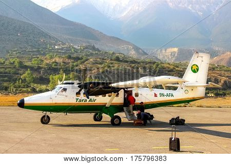 Nepal Himalayas Jomsom Airport - April 2015: Tourists and local people flew on a small plane to the airport in the mountains of Nepal. Jomsom track.