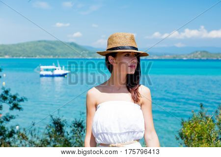 Beautiful Young Woman Standing On The Wonderful Sea Background In Greece