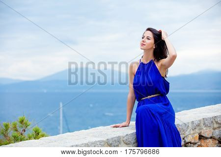 Photo Of Beautiful Young Woman Sitting On The Stairs  In Greece