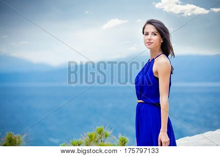 Photo Of Beautiful Young Woman In Front Of The Sea Background In Greece