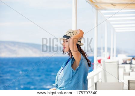 Photo Of Beautiful Young Woman On The Boat In Front Of Sea And Island Background In Greece