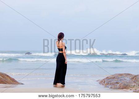 Beautiful Young Woman Standing On The Sand Coast In Sunny Sri Lanka