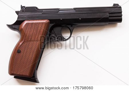 Pistol on a white background. Handle left.