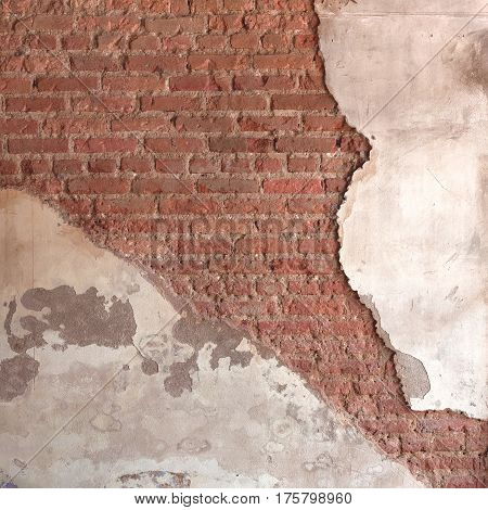 Background broken wall with dirty plaster and old brick. Vintage surface texture. Design of loft grunge surface.