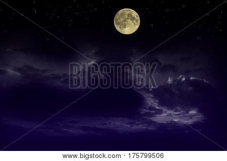Beautiful magic blue night sky with clouds and fullmoon stars.