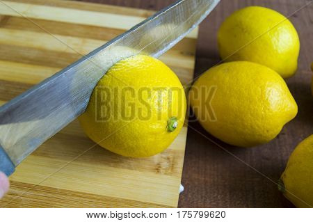 Knife and lemon pictures ready to cut on the tableFresh juicy lemon on top of the salad and fresh for the fish.Ready-to-serve lemon pictures,When the lemon is cut