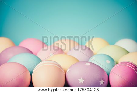 Colorful Easter Eggs border on a teal blue background with subtle vintage styling
