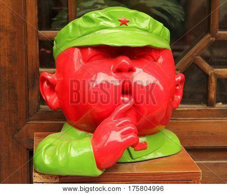 Beijing, China - Jul 4, 2011: Caricature Figure Of Agent Of Communist Secret Service At The Door Of