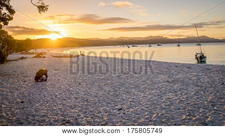 Sunset view of Whitehaven beach at Whitsunday Island in Queensland, Australia. Whitehaven beach is a well known landmark known for its beautiful white sand and clear turquoise wates