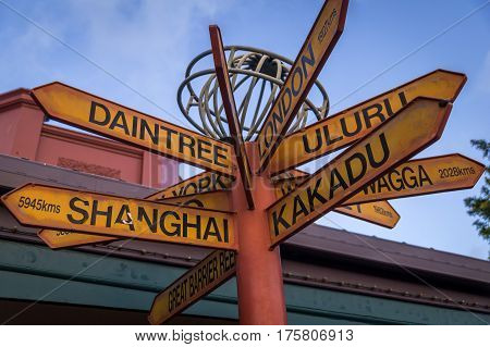 Sign post pointing towards famous landmarks and tourist sites in Australia
