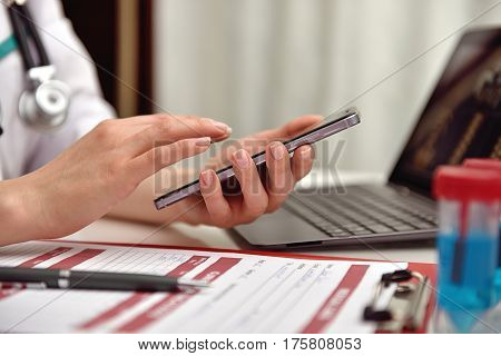 Doctor Holding Phone