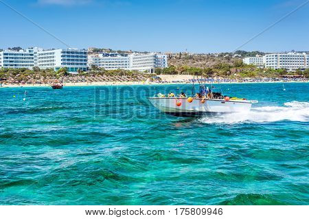 AYIA NAPA CYPRUS - JULY 16 2016: Speedboat cruising in Mediterranean sea along the coast near Ayia Napa.