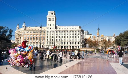 BARCELONA, SPAIN - DECEMBER 11, 2016: Ambiance in the Placa Catalunya in Barcelona, Spain, the square which is considered to be the city center, where some of the most important streets meet together