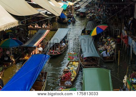 THAILAND DAMNOEN SADUAK - March 20 2016 : Damnoen Saduak Floating Market Featuring many small boats laden with colourful fruits Tourist attraction vegetables and Thai cuisine