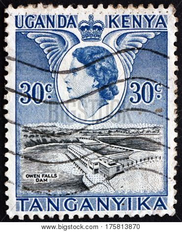 EAST AFRICAN POSTAL UNION - CIRCA 1954: a stamp printed in the East African Postal Union (Kenya Uganda Tanganyika) shows Owen falls dam circa 1954