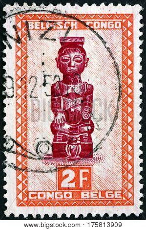 BELGIAN CONGO - CIRCA 1948: a stamp printed in Belgian Congo shows Ndoha Figure of Tribal King Baluba tribe circa 1948
