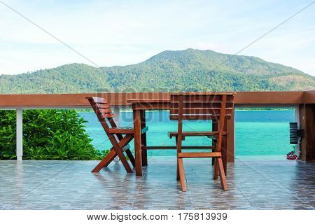 Empty Wooden Table And Chair With Sea Background