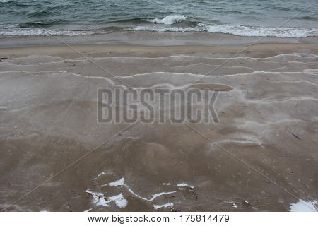 Water frozen on a Lake Michigan beach in Sleeping Bear Dunes National Lakeshore, Michigan