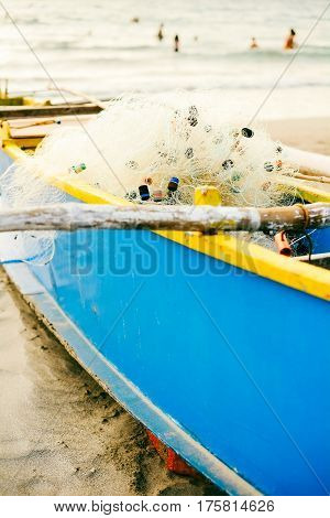 Blue fishing boat parked on the beach