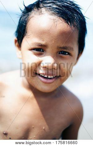 Happy portrait of Asian little girl on the beach