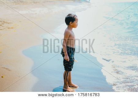 Happy portrait of one little girl on the beach