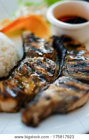 Delicious meal, grilled fish steak barbecue with rice and soy sauce