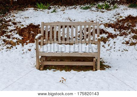 garden bench covered in freshly fallen snow bench covered with snow