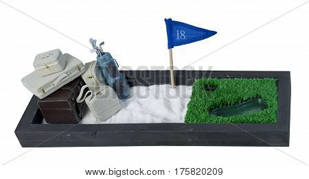 Suitcases and Golf Clubs on an enclosed Golf Course to show a golfing holiday - path included
