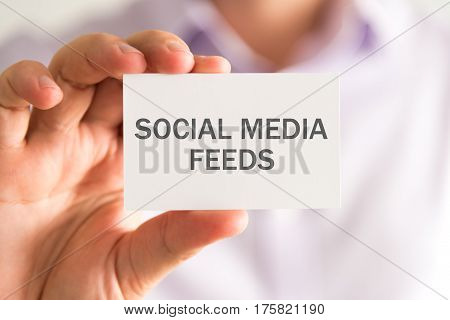 Businessman Holding A Card With Social Media Feeds Message