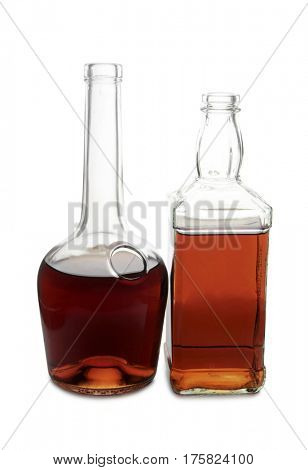 Glass with brandy and whiskey on white background
