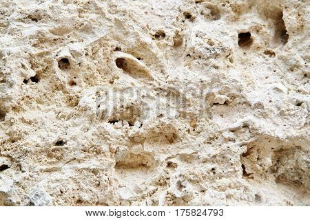 Rough texture of cement wall with holes
