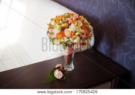 wedding bouquet and boutonniere on the table