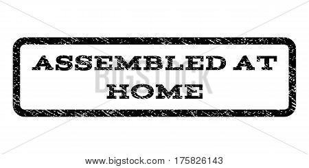 Assembled At Home watermark stamp. Text tag inside rounded rectangle with grunge design style. Rubber seal stamp with scratched texture. Vector black ink imprint on a white background.