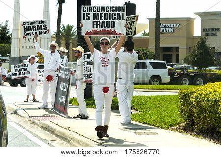 Orlando Florida - March 9th 2017: Public Protest of circumcision at the Millenia Mall entrance in Orlando Florida on March 9th 2017