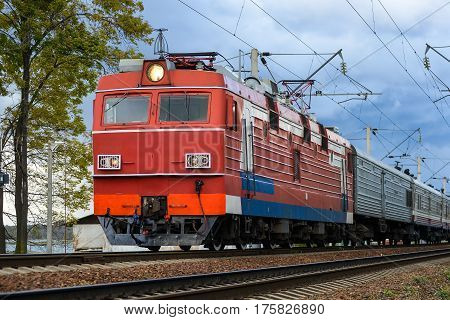 Photo of modern electric train on vintage railroad