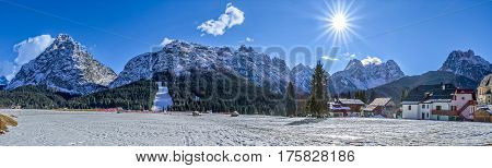Panoramic view of the Pista Nera and mountins on a sunny winter afternoon, Sappada Italy.