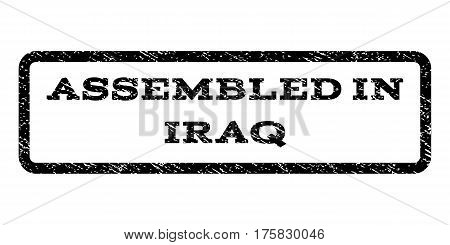 Assembled In Iraq watermark stamp. Text caption inside rounded rectangle with grunge design style. Rubber seal stamp with unclean texture. Vector black ink imprint on a white background.