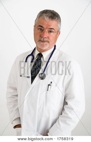 Doctor With Hand In Pockets Doubting Patient