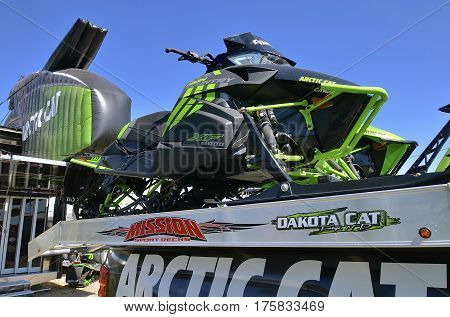 WEST FARGO, NORTH DAKOTA, September 13, 2016. New Arctic Cat snowballs and trailers are displayed at the Big Iron Farm Show held annually at the Red River Fairgrounds each September.