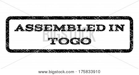 Assembled In Togo watermark stamp. Text caption inside rounded rectangle with grunge design style. Rubber seal stamp with dirty texture. Vector black ink imprint on a white background.