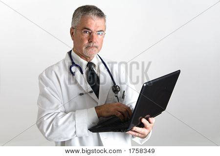 Doctor With Laptop Looking At The Screen