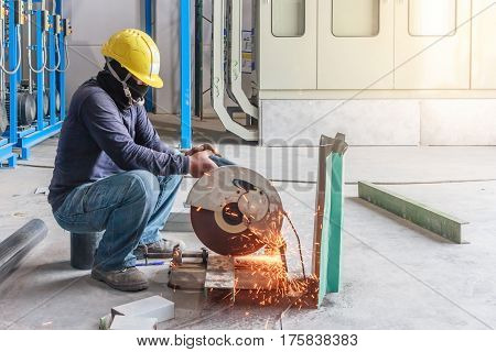 Construction worker working on cutting a metal and steel with compound mitre saw with sharp circular blade