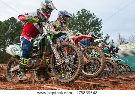 MONROE, GA - DECEMBER 2016:  Riders lunge forward at the start of a motocross race at the Scrubndirt Mx track in Monroe GA on December 3 2016.