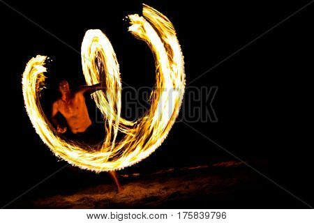 Amazing Fire Show at night on beach Thailand