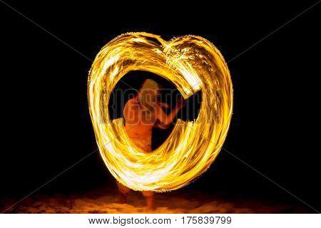 Amazing boy Fire Show at night on beach Thailand