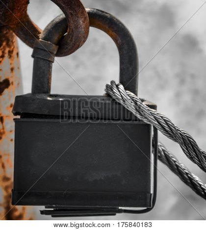 Padlock, new metal padlock on gray background, security, metal rope