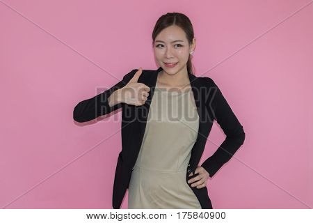 woman in uniform showing thumbs up and like on pink background