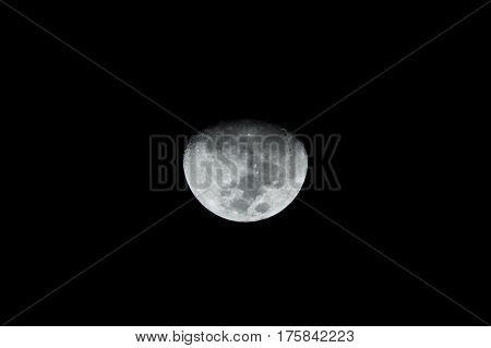 moon view on night sky, bright shadows on half moon rising