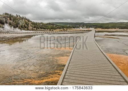 Boardwalk to keep people safe from the extremely hot water and to protect the fragile environment at Midway Geyser Basin in Yellowstone National Park